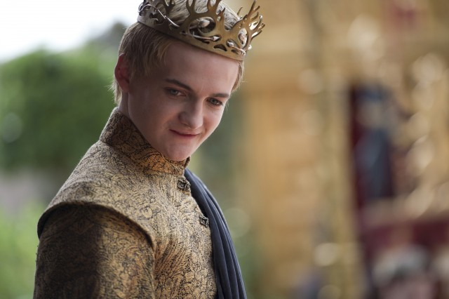 Joffrey is smiling in gold clothes and a crown.