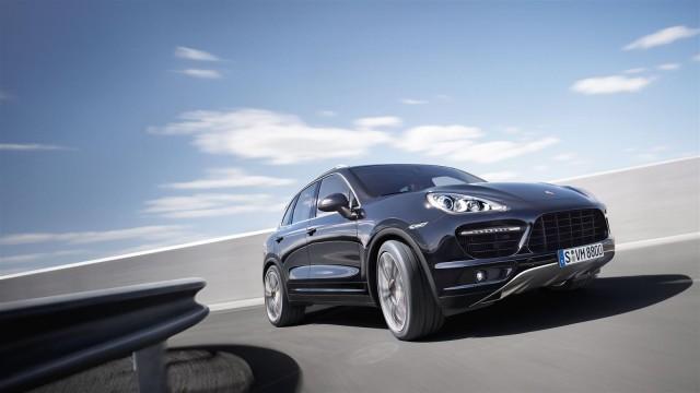 Black luxury vehicle on the road