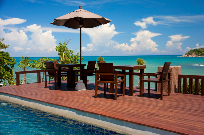 tables and swimming pool on the ocean