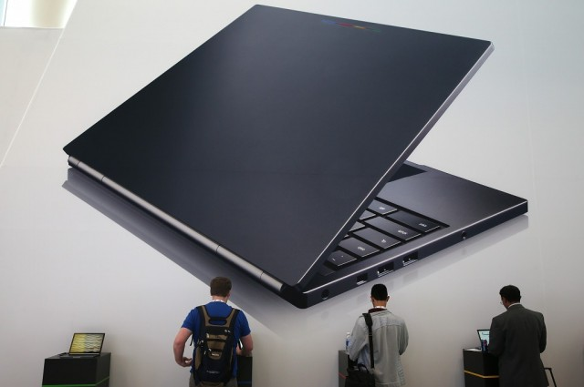 Attendees inspect the Google Chromebook Pixel laptop during the Google I/O developers conference