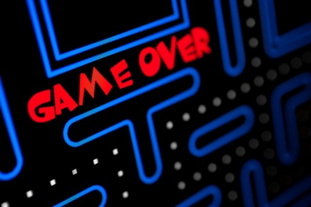"A video game showing ""game over"" on the screen"