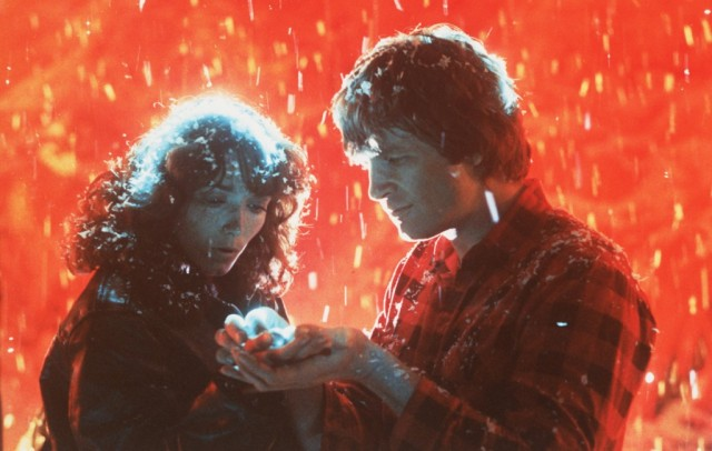 Jeff Bridges and Karen Allen hold hands in Starman