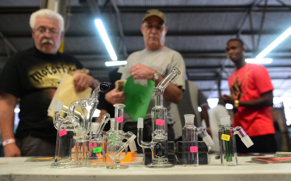 Customers check out an assortment of pipes and glass