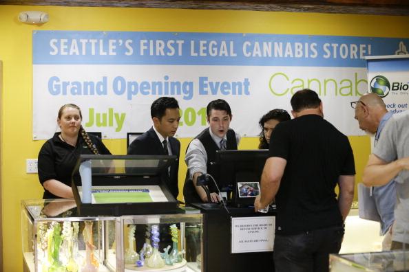Business administrators run a marijuana store