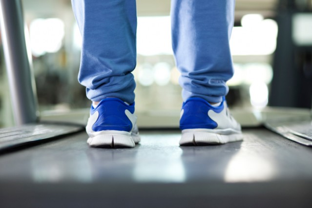 Man standing on a treadmill