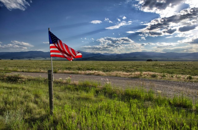 American flag on a fence post