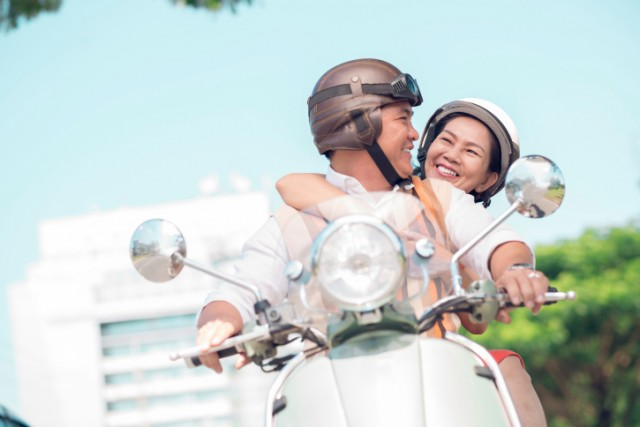 Couple riding on a scooter
