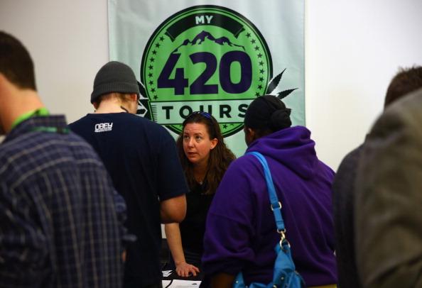 A marijuana tour operator talks to customers