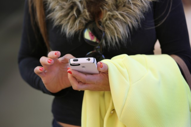 A woman checks her smartphone