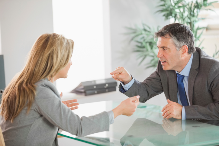 Two people arguing at the office