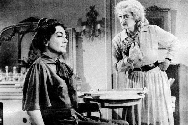 A black-and-white photo of Joan Crawford and Bette Davis in Whatever Happened to Baby Jane?