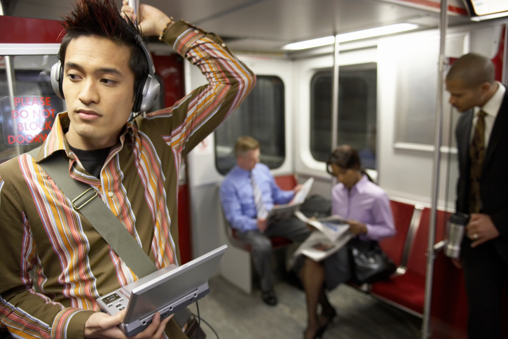 Guy listening to music, going to work