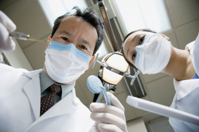 a dentist and dental hygienist