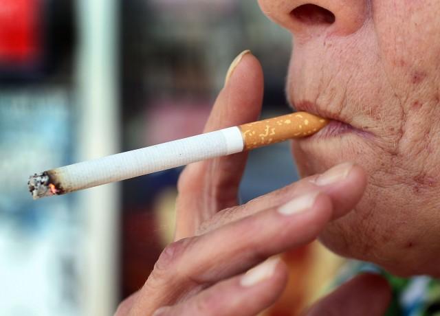 A woman takes a smoke break