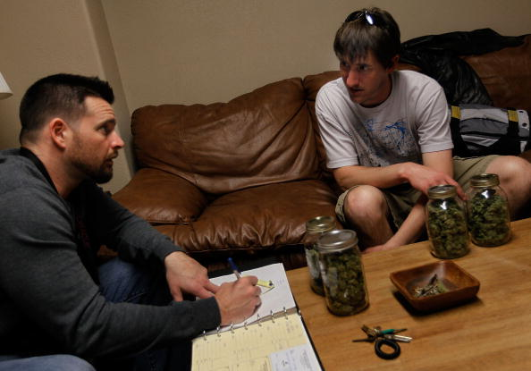 A cannabis consultant meets with clients