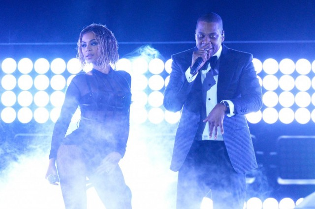 Beyonce and JAY-Z are on stage performing together.