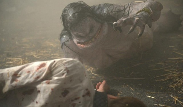 A monster feeds on a body in a scene from Cabin in the Woods