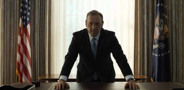 Kevin Spacey with his hands on his desk in the Oval Office in 'House of Cards.'