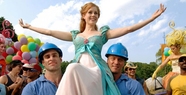 Giselle is lifted by two construction workers.