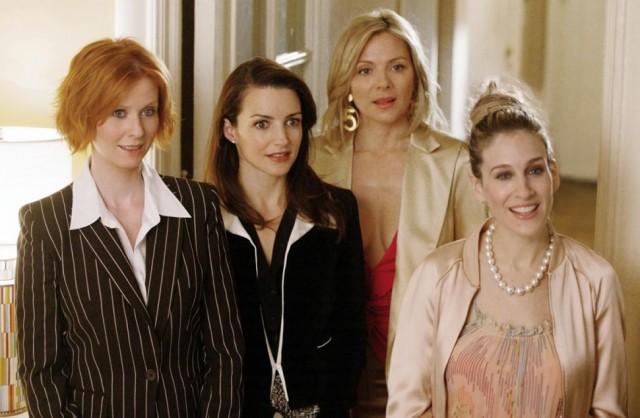 Sarah Jessica Parker and her co-stars stand in a doorway in Sex and the City