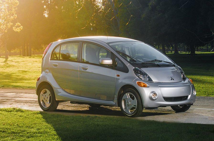 Profile shot of Mitsubishi mini electric car on the road