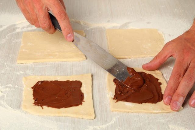 Spreading nutella on puff pastry
