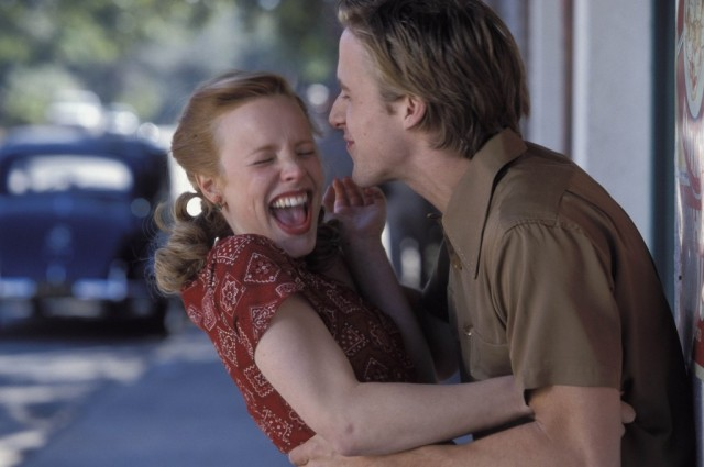 Rachel McAdams and Ryan Gosling laughing on the street in The Notebook