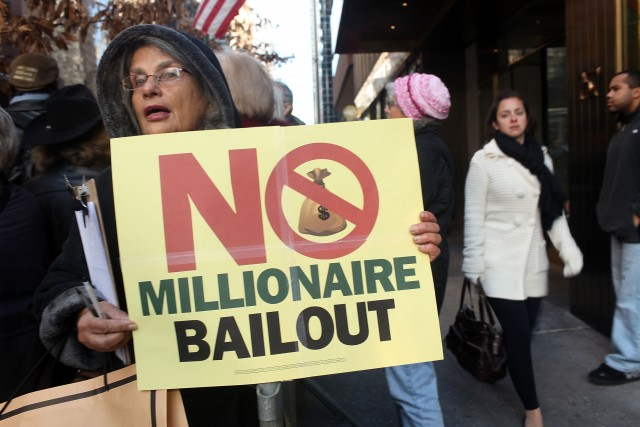 NEW YORK, NY - DECEMBER 02: People attend a rally outside of the office of Sen. Charles Schumer (D-NY) to protest an extension of tax breaks for the wealthiest two percent of Americans on December 2, 2010 in New York City. The protest, which was organized by MorveOn.org, called the tax cuts 'millionaire bailouts' and vowed to pressure Democratic senators to oppose the cuts, which Congress is currently considering extending. (Photo by Spencer Platt/Getty Images)