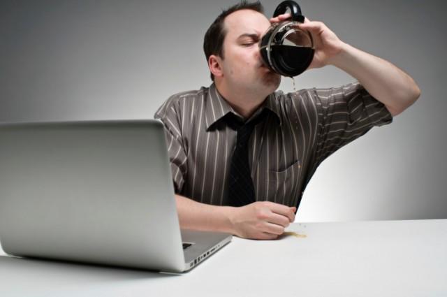 man chugging coffee