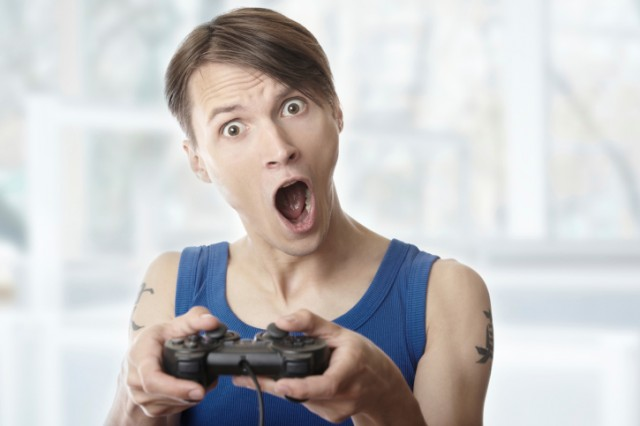 Man looking surprised while playing video games
