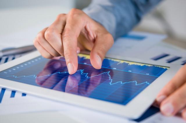 A tablet displays business information