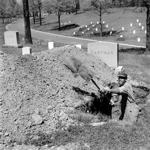 A man digging a grave