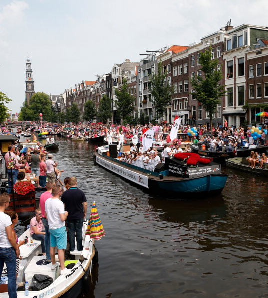 a canal parade travels through the netherlands