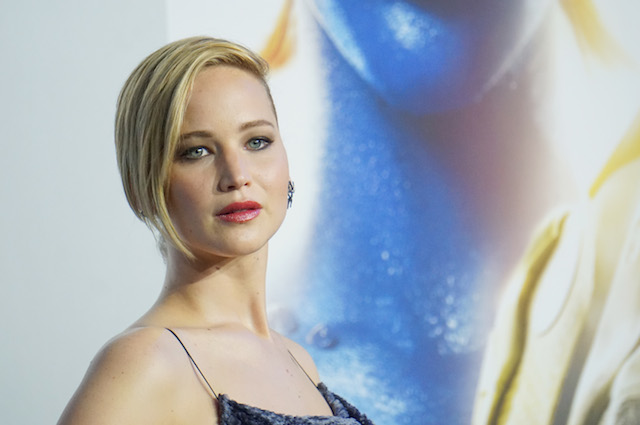 Jennifer Lawrence wears a blue dress while at a movie premiere.