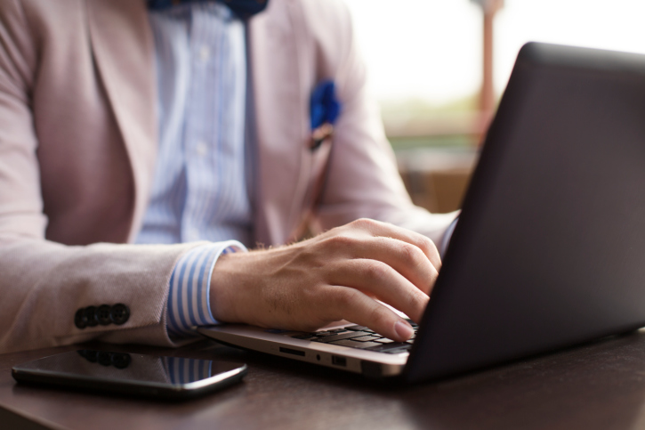 Well-dressed man on computer