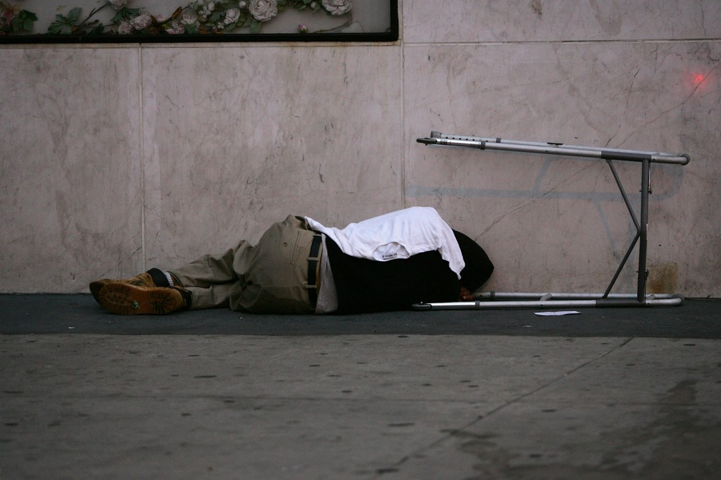 Homeless man sleeping outside