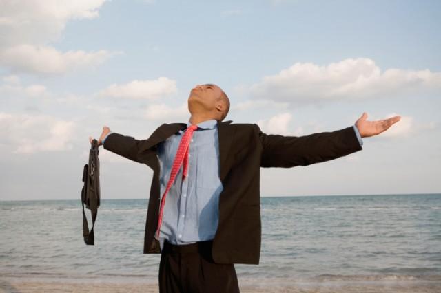 debt-free man celebrating financial freedom