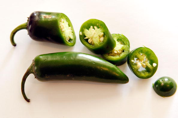 Jalapeno peppers sit on a counter top