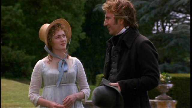 Emma Thompson and Alan Rickman standing in a garden in 'Sense and Sensibility'.
