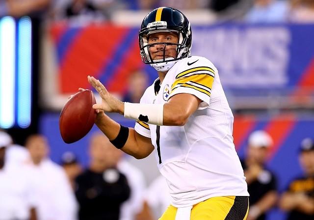 Quarterback throwing football