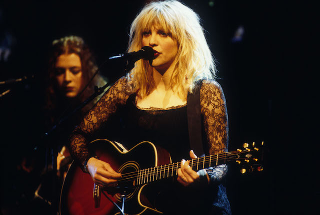 Courtney Love of Hole performs onstage.