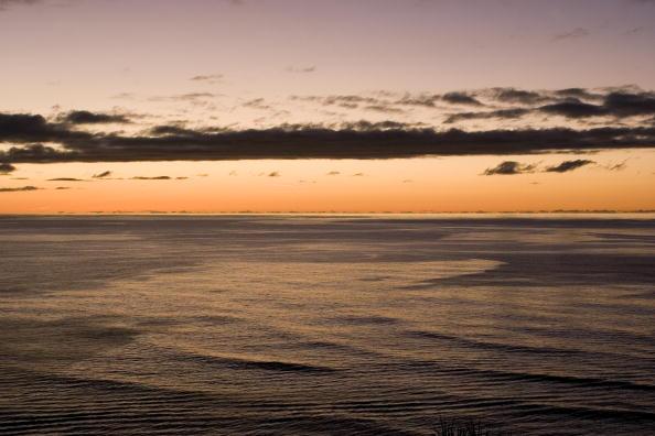 Dusk at sea from the island of Kauai, Hawaii.