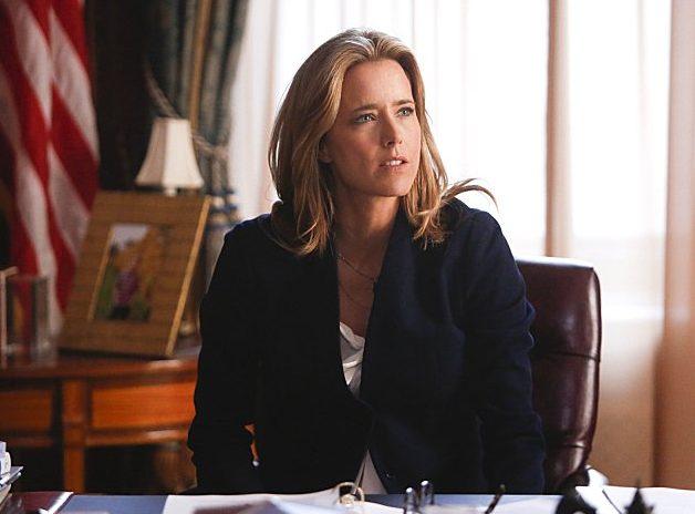 Tea Leoni sits at a desk in an office in Madam Secretary