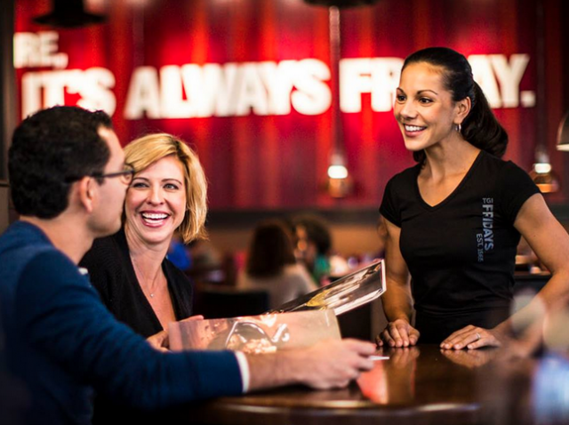 Diners discuss options with a server