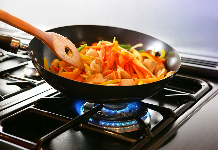 Cooking stir-fry on a stove