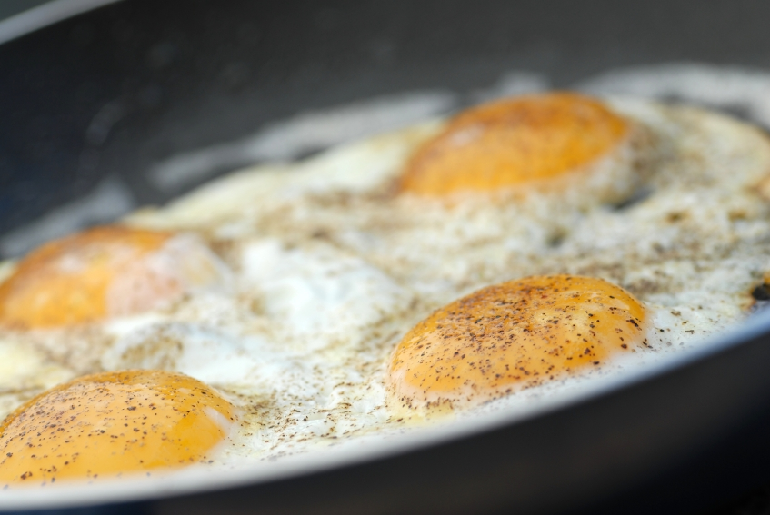 frying eggs in a skillet