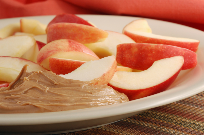 a snack of apples and peanut butter