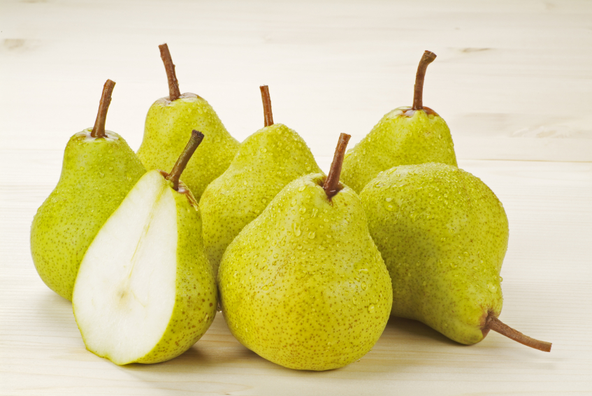 cluster of ripe, green pears on a table