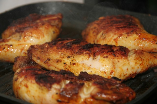 chicken grilling in a pan