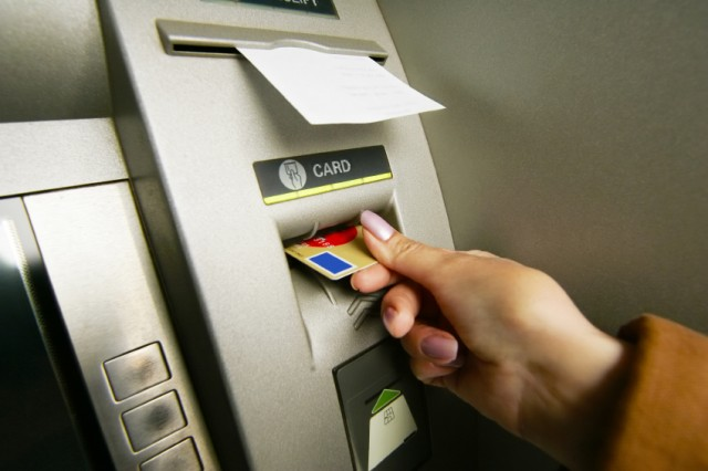 A woman uses an ATM